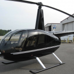 robinson r44 helicopter raven2 black with white stripe